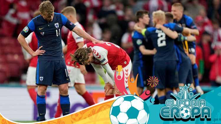 Rasmus Schuller sedang mencoba menghibur Mathias Jensen yang menggantikan Christian Eriksen dalam laga Euro 2020 Denmark vs Finlandia. Copyright: © Martin Meissner - Pool/Getty Images
