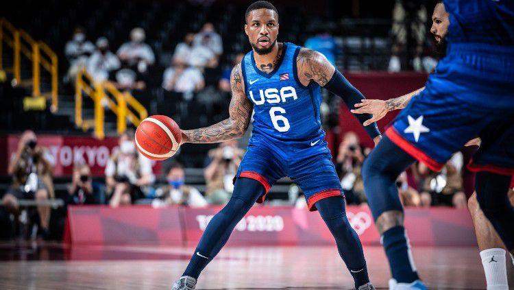 Aksi Damian Lillard di Olimpiade 2020 cabor basket antar Amerika Serikat vs Prancis. Copyright: © twitter.com/usabasketball