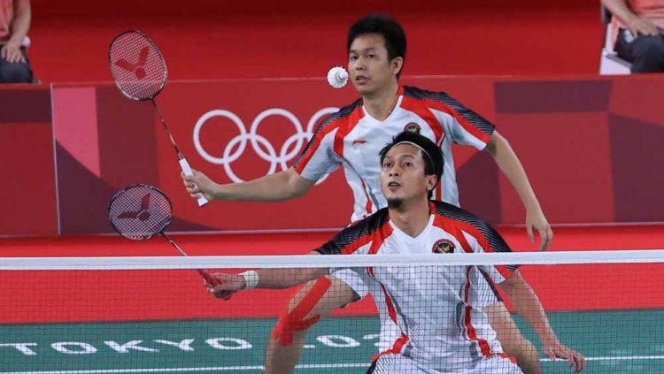 Herry IP tegaskan Mohammad Ahsan/Hendra Setiawan belum tentu menang atas pasangan Malaysia di perebutan perunggu Olimpiade Tokyo, meski punya rekor bagus. Copyright: © NOC Indonesia