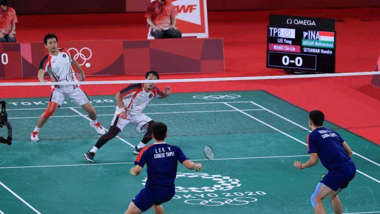 Aksi Mohammad Ahsan/Hendra Setiawan di semifinal Olimpiade Tokyo. Copyright: © NOC Indonesia
