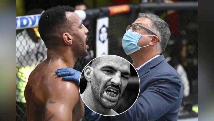 Petarung UFC Devin Clark diperiksa oleh dokter cedera pada gigi saat melawan Ion Cutelaba di UFC Vegas 37. Copyright: © mmamania/Jeff Bottari/Zuffa LLC