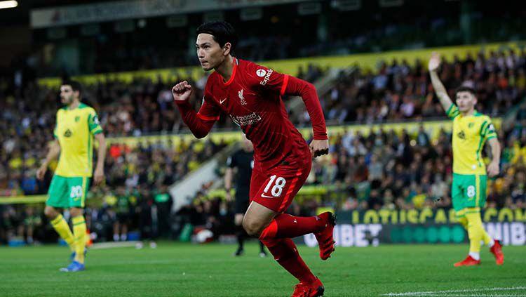 Selebrasi gol Takumi Minamino di laga Norwich City vs Liverpool. Copyright: © REUTERS