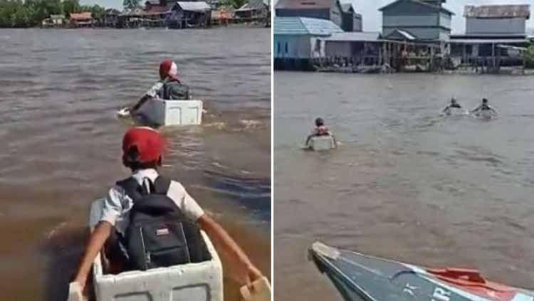 Media sosial dihebohkan video berdurasi 2 menit yang menunjukkan 3 anak SD yang terpaksa menaiki kotak styrofoam untuk menyeberangi sungai demi pulang ke rumah. Copyright: © Twitter/UmarChelsea_70