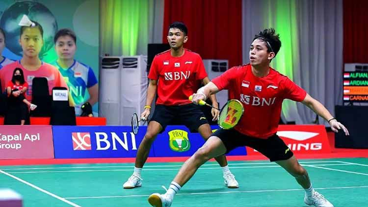 Fajar Alfian/Muhammad Rian Ardianto membuka keunggulan Indonesia atas Kanada di Piala Sudirman 2021. Copyright: © badminton.ina