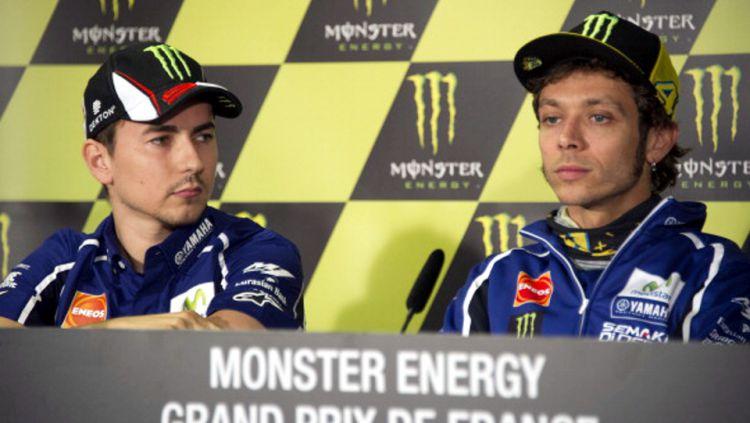 Valentino Rossi menyatakan bahwa kerja samanya dengan Jorge Lorenzo sebagai momen terbaik meski kerap berselisih di atas lintasan balap MotoGP. Copyright: © GETTY IMAGES