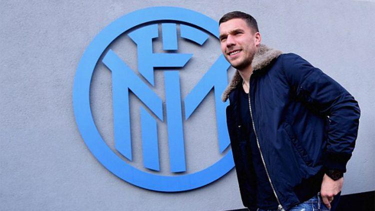 Mantan bintang Inter Milan, Lukas Podolski, kembali ke Jerman untuk mengurus kedai es krim miliknya. Copyright: © GETTY IMAGES